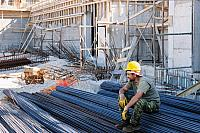 kozzi-1074164-construction worker resting on steel bars-883x588