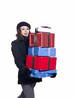kozzi-195325-female in winter clothes holding a stack of christmas presents-1254x1673